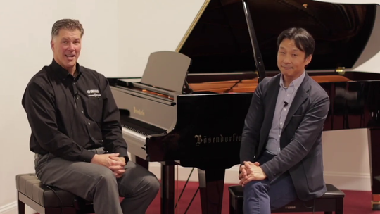 Cunningham Piano co-owner Rich Galassini and artist in residence and pianist Hugh Sung are shown at the piano. The pair, along with co-owner Tim Oliver, helped create a virtual Mozart concert which utilized more than 100 musicians and vocalists from around the world.