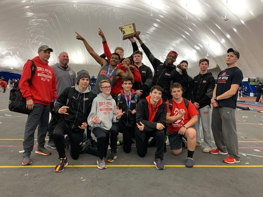The Delsea Regional High School boys track and field team celebrates after winning the Group 2 state indoor title on Feb. 29.