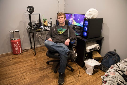 Unioto student Connor Fox sits in front of his computer and 3-D printer where he has made several masks for medical professionals in Adena's emergency room to help protect form accidental infection of the coronavirus. Fox is 17 and combined his love of robotics and doing what he could to help those who are risking their lives in the medical field.