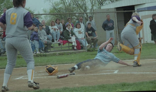Adena's Lisa Lightle slides home safely on a base hit by Jennifer Wood. In 2000, Adena defeated Unioto 13-3 to capture the SVC title.
