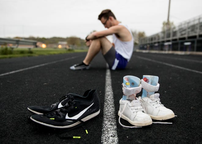 """Eric Hacker's """"From braces to track cleats"""" image took second place in the Associated Press 2019 awards for best sports photo. According to the judge, """"A very powerful photo that conveys so much, even with no action. The photo and corresponding story are very powerful and the shoes and braces pictured on the track illustrate perfectly just how far the runner has come in a difficult journey."""""""