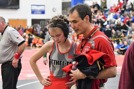 Bethel-Tate head coach Tom Donahue speaks with his daughter, Trinity, during the OHSWCA all-girls state tournament.