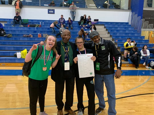 Badin fans and wrestlers having fun after the OHSWCA state tournament were, from left, Brooke Weisbrodt, head coach Dexter Carpenter, Sam Caballero and coach Dwight Pringle.