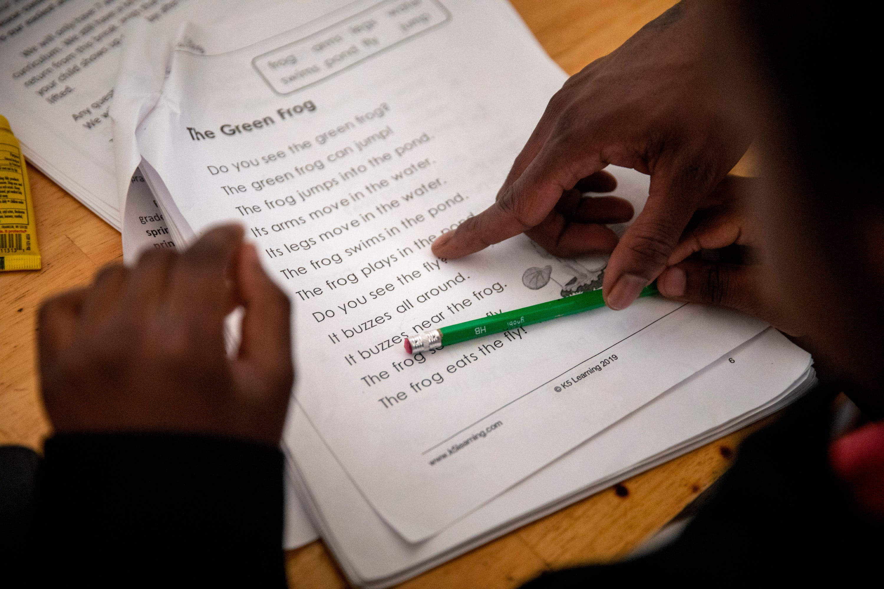 Renee Oliver helps her son Sinaca Wagoner, Jr. 7, with his school work in their apartment in Lower Price Hill on Thursday, April 2, 2020. Sinaca Jr. is in the second grade at Cincinnati College Preparatory Academy.