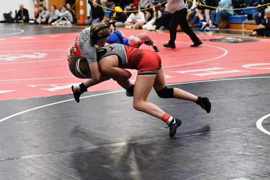 Lakota West's Grace Hicks, right, wrestles during the girls state tournament.
