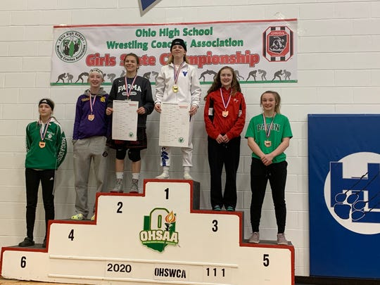 The state-placers in the 111-pound weight class at the OHSWCA girls state championship were, from left: Camryn Manley (Mogadore, sixth place), Peighton Irish- Arnett (Reynoldsburg, fourth), Liz Matis (Parma, second), Olivia Shore (Miami East, champion), Trinity Donahue (Bethel-Tate, third), and Brooke Weisbrodt (Badin, fifth).