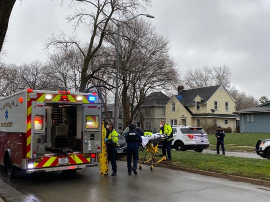 Emergency responders on the scene near 35th Street and Kingman Boulevard in Des Moines after a shooting April 3, 2020.