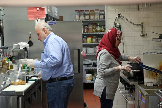 Husband and wife co-owners Ammar Zein and Nahed Lotf work in the kitchen of their Syrian restaurant Pattternz in Sterling Heights on Sunday, March 29, 2020.