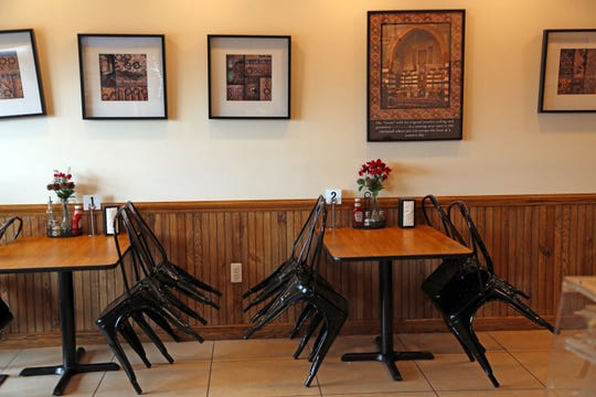 The empty dining room at Pattternz Syrian restaurant in Sterling Heights on Sunday, March 29, 2020.