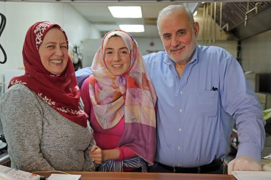 Nahed Lotf, left, with her daughter Gazal Zein and husband Ammar Zein at their family-run Syrian restaurant Pattternz in Sterling Heights on Sunday, March 29, 2020.