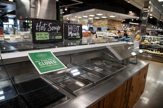 Salad bar and hot food bar are closed at Busch's Fresh Food Market in Canton, Friday, April 3, 2020.