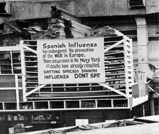 In this Oct. 19, 1918 photo provide by the U.S. Naval History and Heritage Command a sign is posted at the Naval Aircraft Factory in Philadelphia that indicates, the Spanish Influenza was then extremely active.