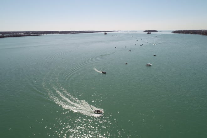 People fish on the Detroit River near Grosse Ile on April 3.