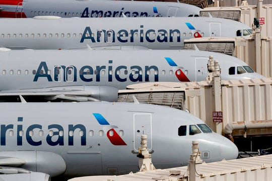The government's top experts in infectious diseases on Tuesday criticized American Airlines' decision to pack flights full while the coronavirus outbreak continues to grow across much of the United States.