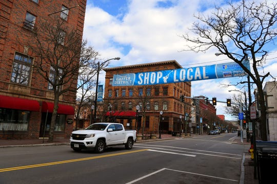 """Usually a busy retail and dining district, W. Market St. in Corning appears quiet, as non-essential businesses remain closed under Gov. Cuomo's """"New York on Pause"""" order. The directive aims to stop the spread of the deadly coronavirus throughout the state and nation. April 2, 2020."""