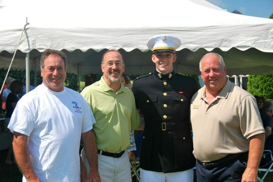 Jim Darcangelo (far right) with brothers Francis (far left) and Mark and son Jaret at Jaret's graduation from the U.S. Naval Academy.