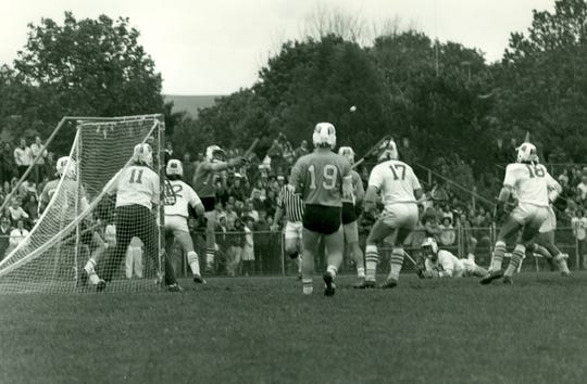Jim Darcangelo (10) makes a pass during his playing career at Towson University. He was a two-time NCAA Division II/III Player of the Year at Towson.
