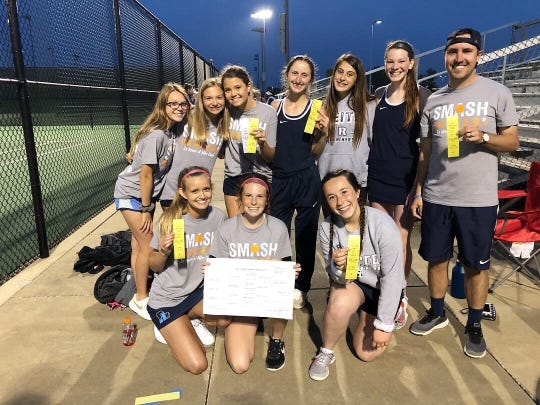 The Reitz girls tennis team celebrates during the 2019 SIAC Tournament. Coach Cole Claybourn, far right, was going to coach this group one final year because of the senior class.