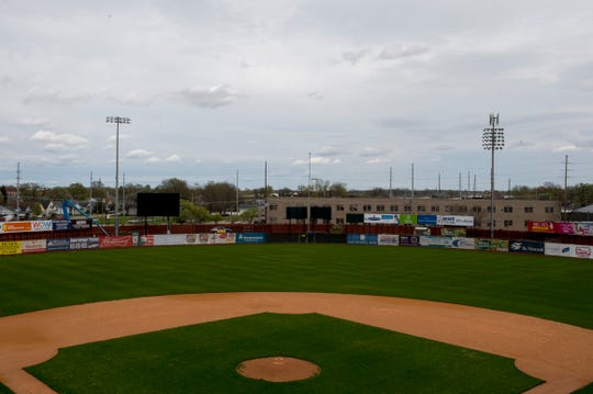 New LED lights are installed on the left as historic Bosse Field undergoes renovations in Evansville, Ind., Tuesday afternoon, March 31, 2020. The new lights require 12 units per pole to illuminate the field while the pervious required 30.