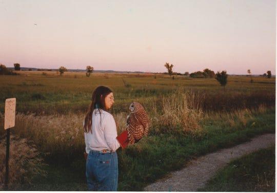 Barbara Harvey releasing a barred owl she rehabilitated near the Horicon National Wildlife Refuge
