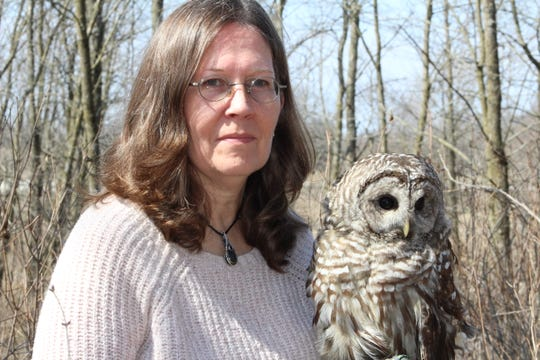 Renee Wahlen with Peek-a-boo, a barred owl, who was one of Barbara's birds. Peek-a-boo had been hit by a car and injured his wing so he cannot fly anymore.