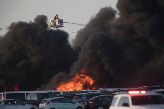 A fire burns near RSW on Friday