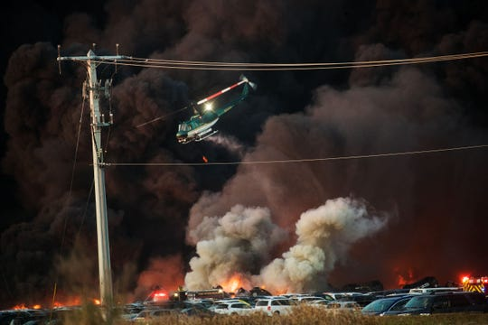 A fire burns near RSW on Friday.
