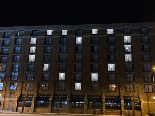 Windows are lit in the Hyatt Regency in downtown Green Bay to show a heart during the coronavirus pandemic.