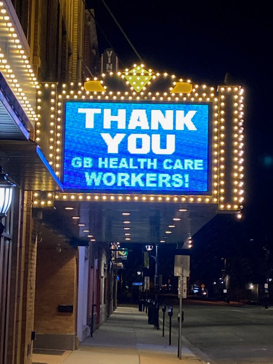 The Meyer Theatre marquee in downtown Green Bay is flashing signs of support.