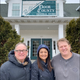 Michael Schwantes of Creative Business Services, left, with Gigi and Andy Wagener of Red Oak Winery in front of the former Door County General Store and Pet Expressions in Carlsville, which the owners of Red oak bought and where the winery will move from Sturgeon Bay.
