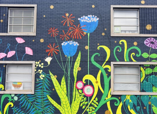 A mural on the side of a building on Stone Ave.