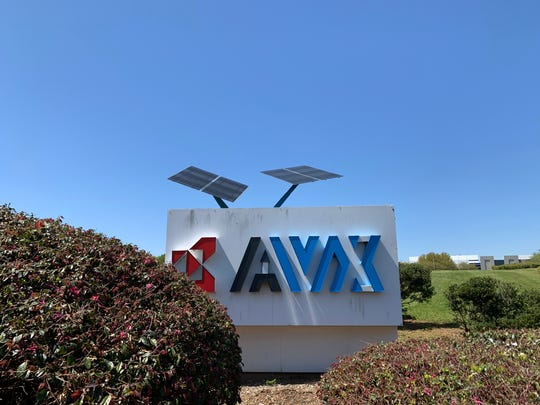 The sign outside AVX Corporation in Fountain Inn is pictured on Friday, April 3, 2020.