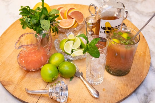 Ingredients include pink grapefruit juice, mint leaves, lime juice, and Mount Gay rum.