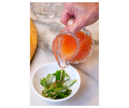 Muddle mint leaves with sugar and a splash of pink grapefruit juice.