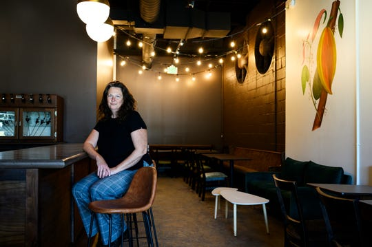 Elizabeth McDaniel poses for a portrait at LaRue Fine Chocolates Friday, April 3, 2020. McDaniel decided to open LaRue, in the making for three years, despite the challenges of operating a business amid the novel coronavirus pandemic.