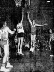 Browning's Murray Harwood (20) contests a shot in a Northern B divisional game against Conrad in March of 1958.