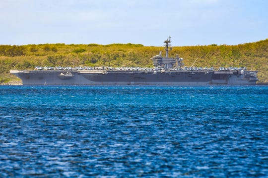 The U.S.S. Theodore Roosevelt, a Nimitz-class nuclear powered aircraft carrier, is docked along Kilo Wharf of Naval Base Guam in Sumay on, April 3, 2020. On Friday, 31% of the crew had been tested for COVID-19 and 114 sailors tested positive so far, said acting Navy Secretary Thomas Modly.