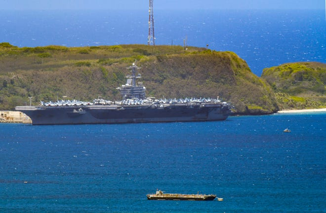 The U.S.S. Theodore Roosevelt, a Nimitz-class nuclear powered aircraft carrier, is docked along Kilo Wharf of Naval Base Guam in Sumay on Friday, April 3, 2020.