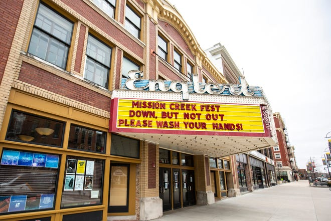 "The marquee at the Englert Theatre reads, ""Mission Creek Fest down, but not out,"" and ""Please wash your hands!"", Friday, April 3, 2020, in downtown Iowa City, Iowa."