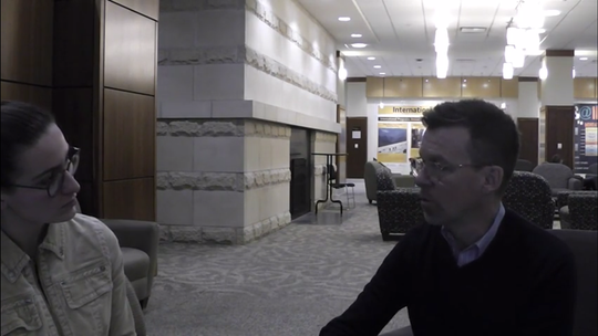 "Iowa City City High junior Caleigh Stanier interviews Iowa Sen. Joe Bolkcom in the lobby of the Iowa Memorial Union for her documentary ""A Shift in Priorities."""