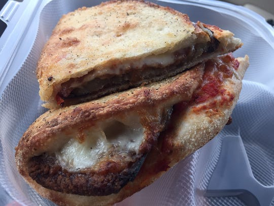 An eggplant Parmesan wedge with deep-fried eggplant slices, tomato basil sauce and mozzarella from Hot Stone Pizza.