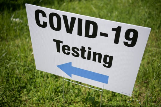A COVID-19 Testing sign pointing to a drive-through testing site at Zoo Knoxville in Knoxville, Tennessee on Friday, April 3, 2020. KCHD has partnered with Kroger Health and the City of Knoxville to facilitate the drive-thru testing opportunity for qualifying individuals in Knox County. The two-day event will take place from 10 a.m. to 5:30 p.m. on Friday, April 3 and Saturday, April 4.