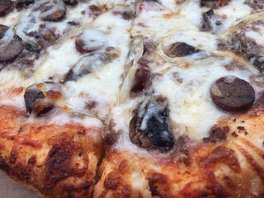 Hot Stone Pizza's ground beef, Italian sausage, onion and mushroom pizza.