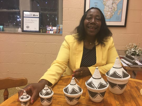 Drocella Mugorewera, former Rwandan cabinet minister, with her collection of African nesting baskets. As executive director of Bridge Refugee Services, Mugorewera, her organization and volunteers strive not only to help refugees newly arrived in the U.S., but to correct misconceptions about the immigrant population in general. June 11, 2019.