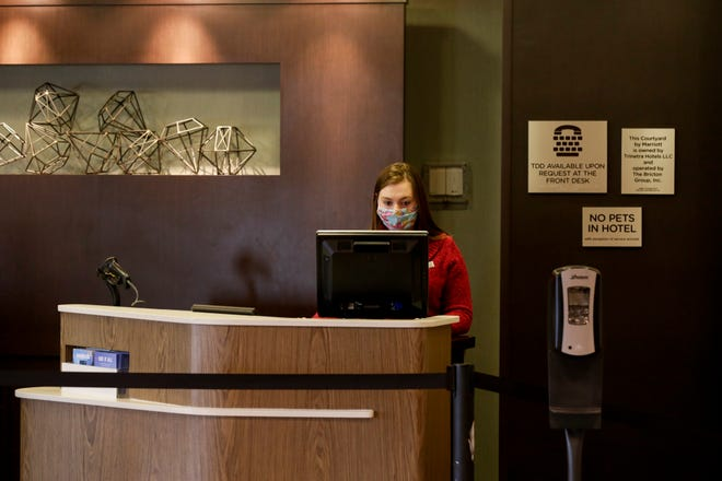 Kaitlyn Byanksi works at the front desk of The Courtyard by Marriott, Friday, April 3, 2020 in Lafayette.