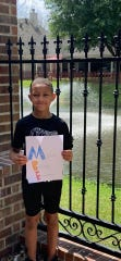 Jason, a second-grader at Martial F. Billeaud Elementary in Broussard, colors a picture at home during Virtual Art Day hosted by the school.