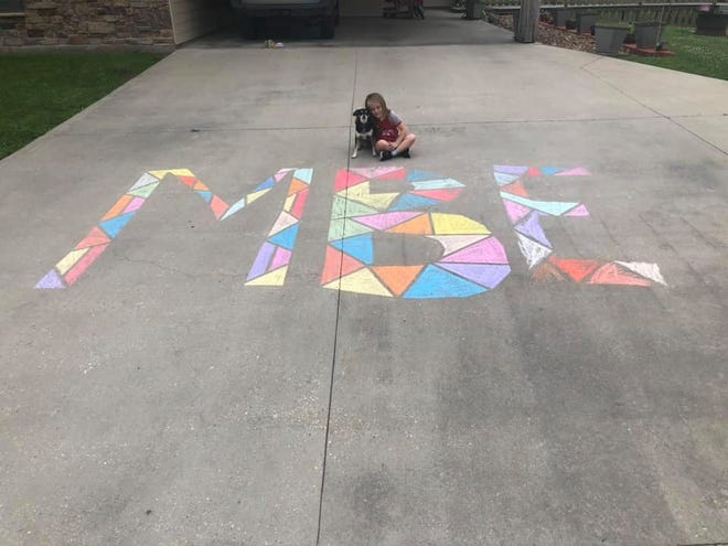 Darce, a first-grader at Martial F. Billeaud Elementary in Broussard, uses sidewalk chalk to make a stained glass picture at home during Virtual Art Day hosted by the school.