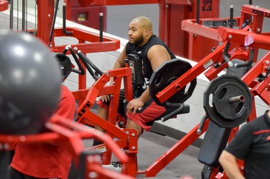 Ex-UL defensive lineman Karmichael Dunbar, now a Ragin'  Cajuns strength and conditioning staffer, sits during his Pro Day in the school's weight room, which currently is shut down due to the country's coronavirus pandemic.