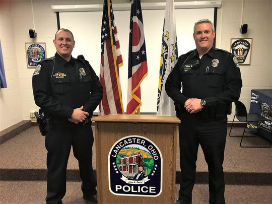 Lancaster police officers Chuck Sims (left) and Jim Marshall work in the department's community service division. Their work includes teaching school students the dangers or drugs and alcohol through the Drug Abuse Resistance Education (D.A.R.E.) program.