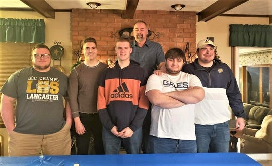 Lancaster track and field throwers had a preseason dinner for the seniors, their parents. The seniors, standing with their coach, Jack Cheek, from left to right, are Dalton Golden, Adam Nebbergall, Bryse Roush, Noah Burnside and Bryann Connell.